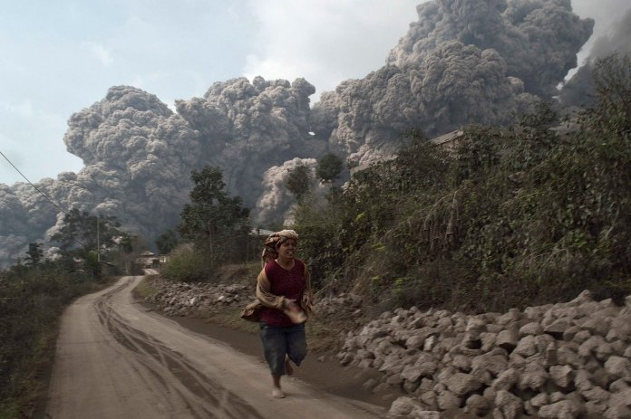 Indonesian Volcano Erupts Killing 14 Time