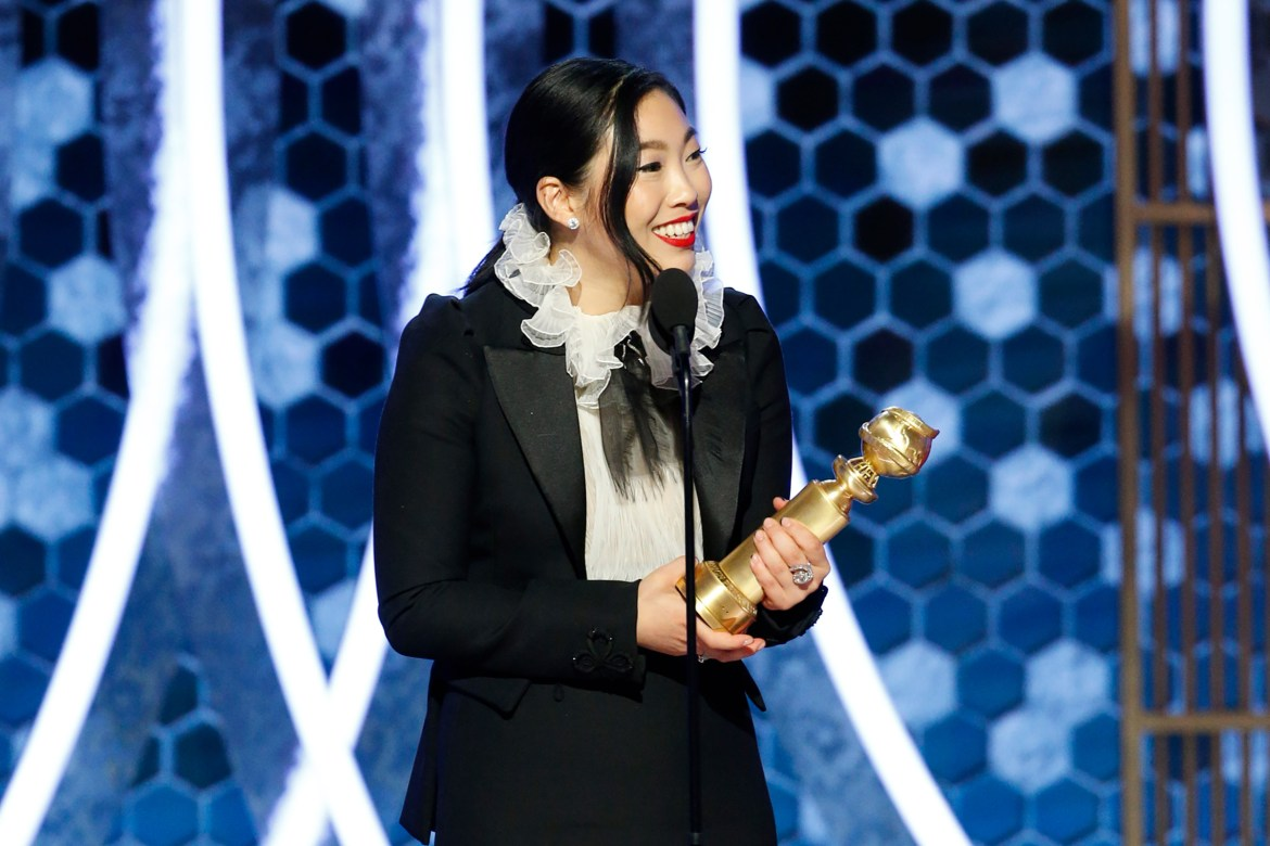 Awkwafina accepts the award for best performance by an actress in a motion picture - musical or comedy for  The Farewell  onstage during the 77th Annual Golden Globe Awards.
