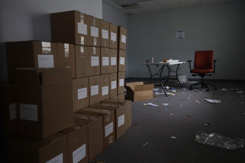 Boxes of voters registration forms are stacked in a space that the Iowa Democratic Party occupied near its headquarters in Des Moines, Iowa, on February 4, 2020.