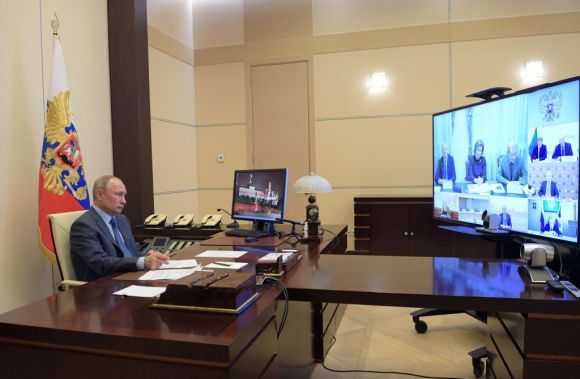 Russian President Vladimir Putin chairs a video conference meeting on the COVID-19 situation, at the Novo-Ogaryovo state residence outside Moscow on April 20, 2020.