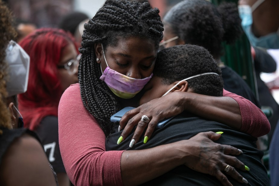 Friends and family mourn the death of Conrad Coleman Jr. on July 3 in New Rochelle, N.Y. Coleman, 39, died of COVID-19 on June 20, just over two months after his father also died of the disease