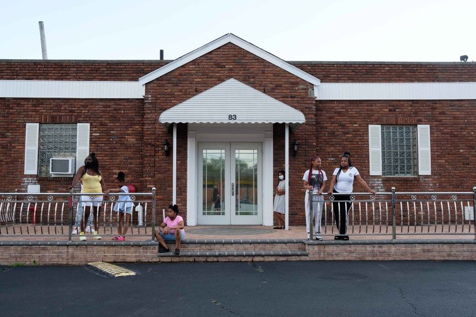 Family and friends gather outside Judea United Baptist Church during Jamel Floyd's wake in Hempstead, N.Y. on June 29.