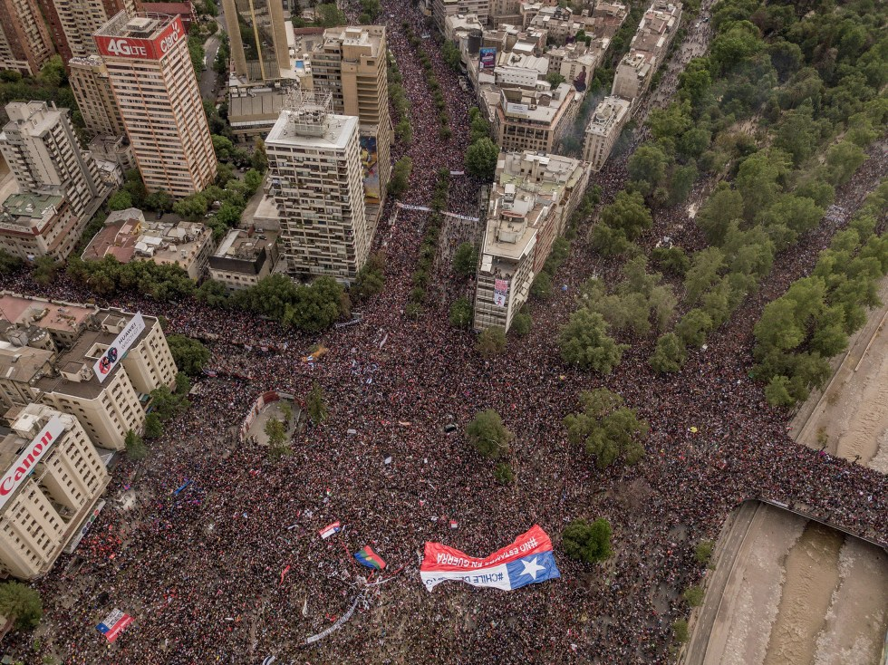 Protesters take to the streets in Santiago, Chile, Oct. 25, 2019. (Tomas Munita/The New York Times)
