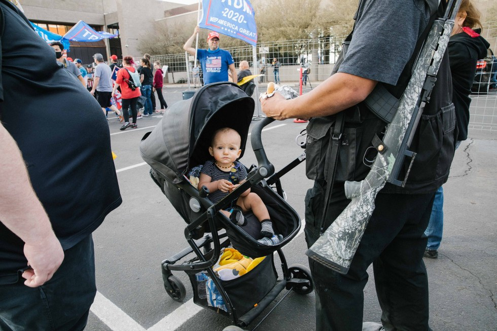 A baby and a gun at the Maricopa County Elections office in Phoenix, AZ on November 7, 2020