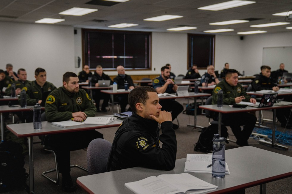 Police recruits attend a criminal law class.