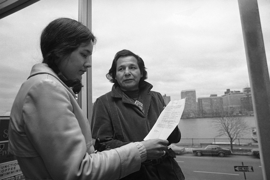 in this Nov. 4, 1971 file photo, Eddie Benton, a holy man of the Chippewa Indian Tribe, shows a prayer he wrote to Linda Jeffers, of Vineyard Haven, Martha's Vineyard, Mass., a member of the Wampanoag Tribe in Cambridge, Mass.