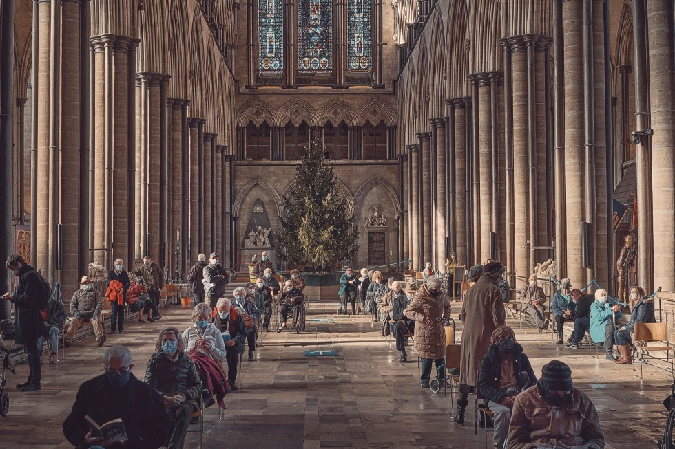 Salisbury Cathedral functions as a COVID-19 vaccination site in Salisbury, England on Jan. 23 2021. (Tom Jamieson/The New York Times)