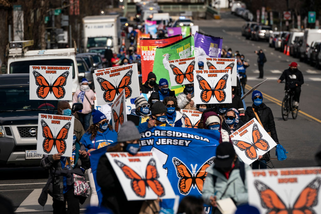 Activists and citizens with temporary protected status (TPS) march along 16th Street toward the White House in a call for Congress and the Biden Administration to pass immigration reform legislation in Washington, DC, on February 23, 2021.