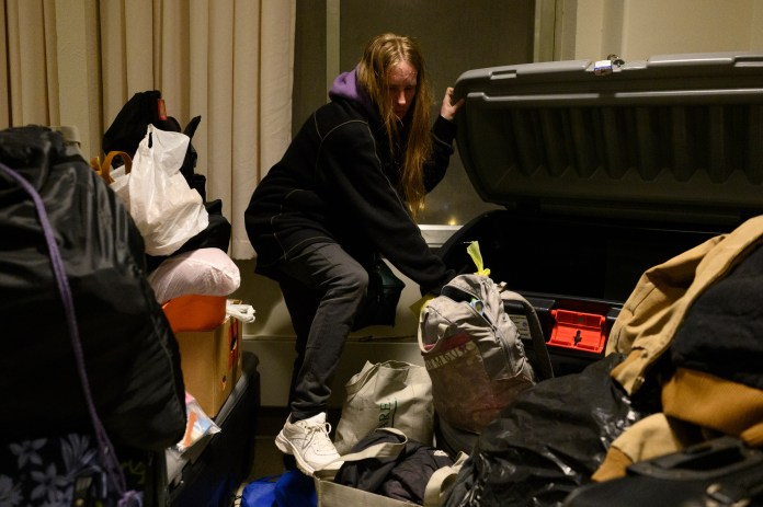 Dylon collects her belongings stored at the Winter Freeze shelter on March. 15 before having to move outside.