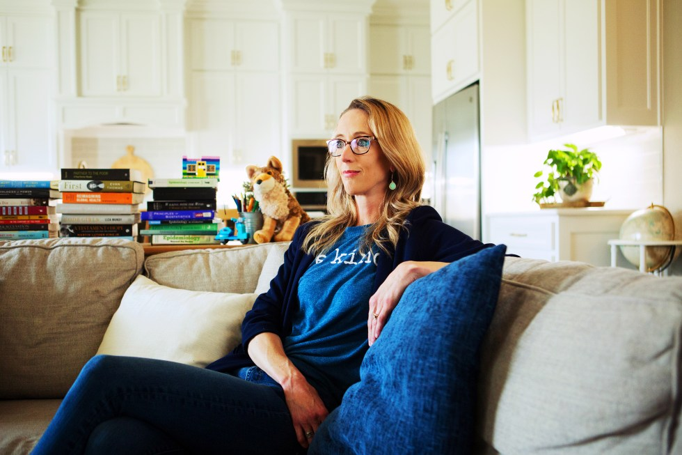 Emily Smith, who runs the Facebook page Friendly Neighbor Epidemiologist, in her home near Waco, Texas