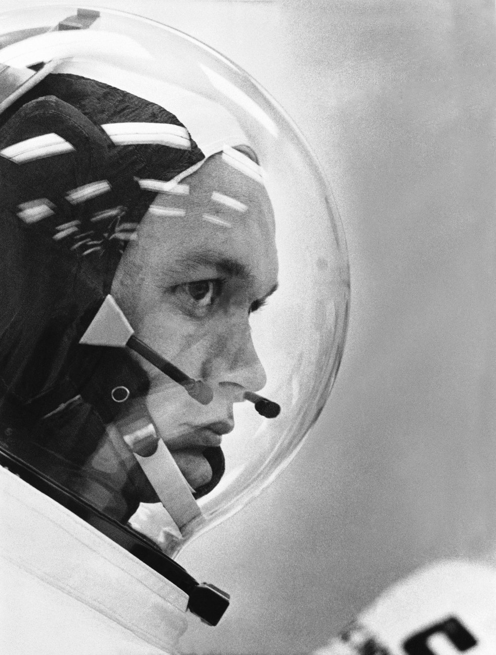 Astronaut Michael Collins wears his space helmet for the Apollo 11 moon mission, on July 20, 1969.