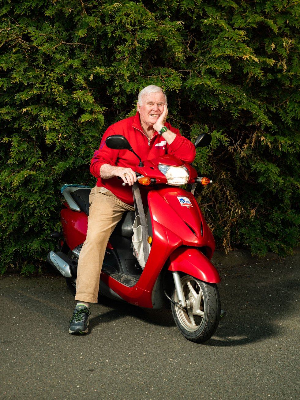 Jim Byrne poses for a portrait with his scooter outside of his home in Connecticut.