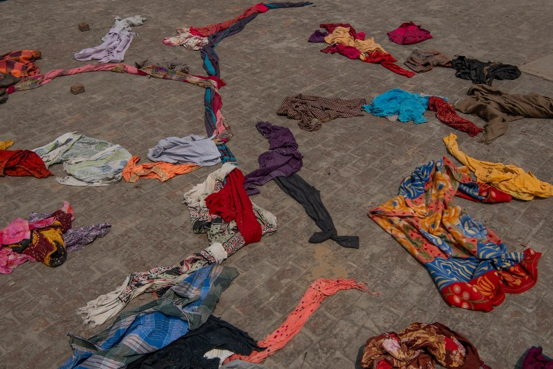 Clothes of the deceased lie on the terrace of a building within crematorium premises in New Delhi on April 27.
