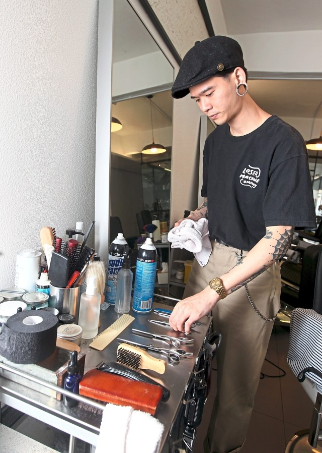 Kevin Tan opened his own barbershop simply because he thoroughly enjoys the entire process of barbering from cutting hair to connecting with his clients. Photo: KAMARUL ARIFFIN/The Star
