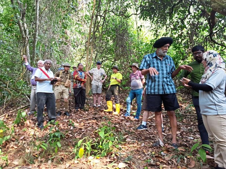 'Malaya at War' conference tour members visiting the Green Ridge, the historical site of the Battle of Kampar.