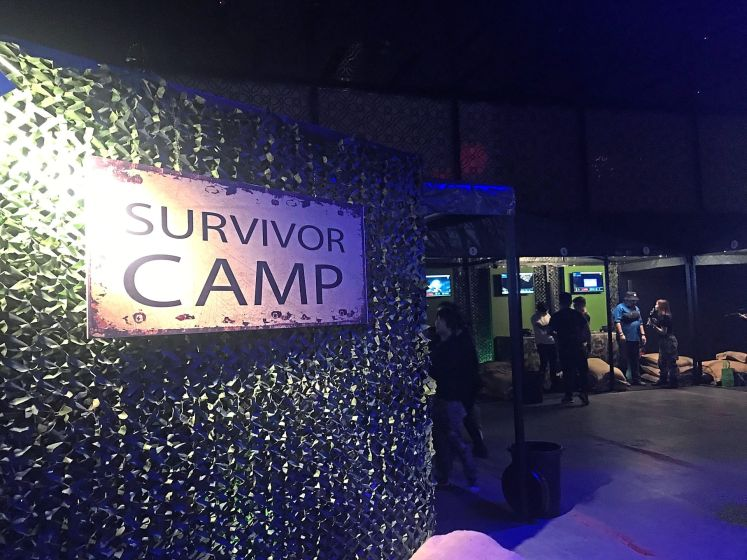 Defend the base camp against zombies at the virtual reality game at Resorts World Genting. — CHESTER CHIN/The Star