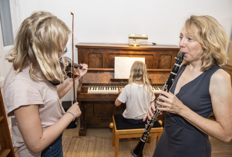 Carola Misgeld (right), a 50-year-old mother of six and a senior physician in the emergency department at Berlin's Charite hospital, started playing the clarinet a few years ago. Photo: Robert Günther/dpa