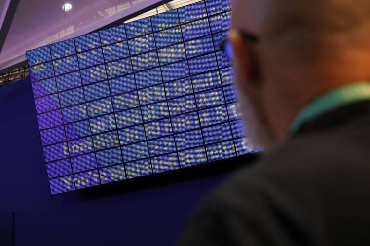 An attendee looking at a screen with information unique to him as part of the 'Parallel Reality' experience at the Delta Air Lines booth during the CES tech show. The parallel reality screens are a type of personalised signage that shows custom messages of flight information to multiple travellers simultaneously. — AP