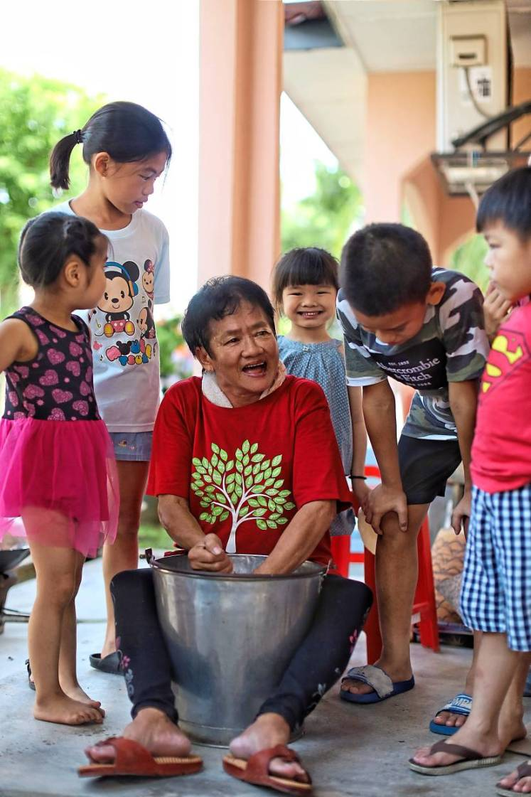 Goh hopes her young nieces and grandchildren will learn the art of making kuih bahulu, the traditional way.