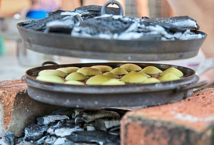 It takes skill to control the fire and to ensure the kuih bahulu isn't overcooked.