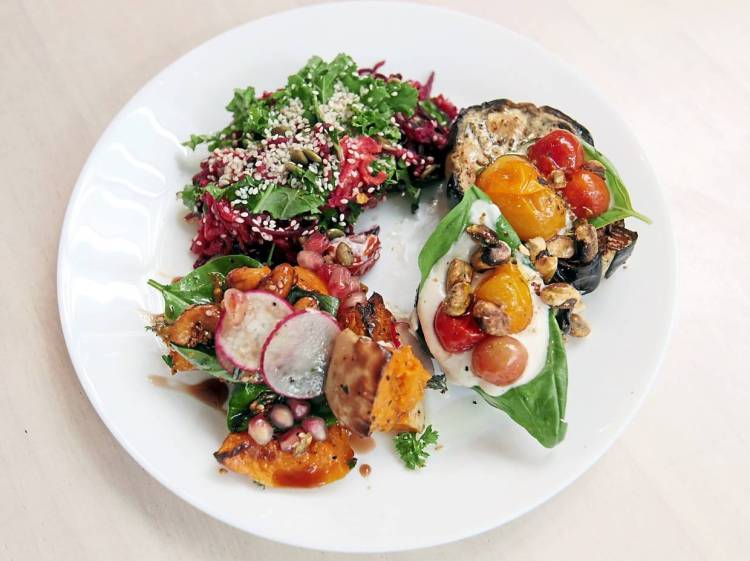 The restaurant serves a wide assortment of salads  that offer fresh, balanced flavours. Clockwise from bottom left: roasted butternut squash, beetroot, kale and carrot slaw and  roasted eggplant.