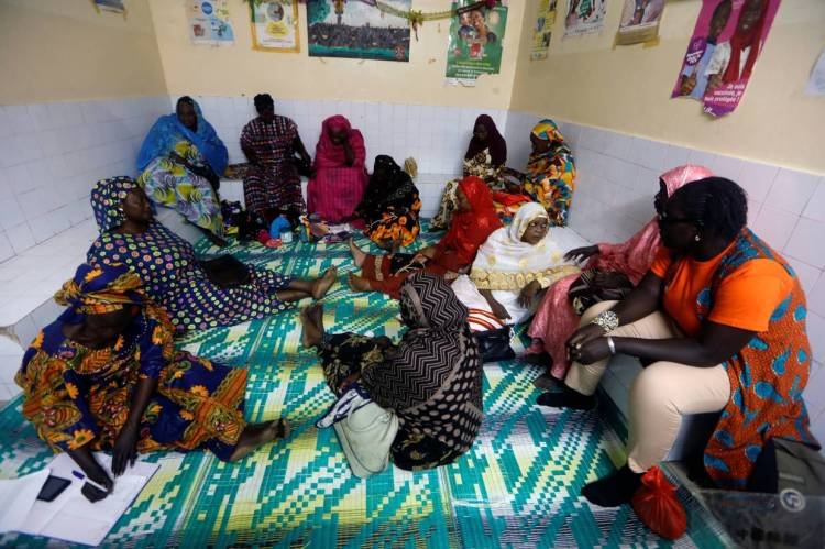 Warkha meeting with women in a medical center as they prepare an awareness campaign against malaria in Pikine.