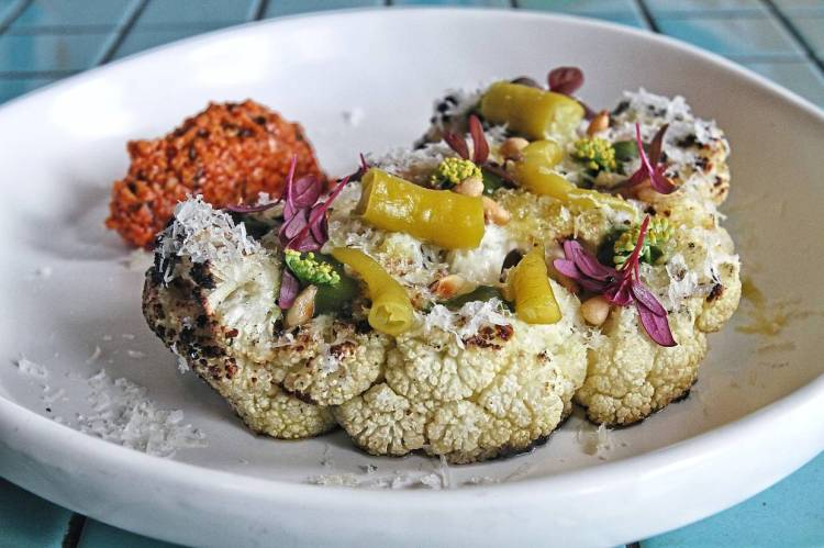 The roasted cauliflower pays tribute to the cruciferous vegetable's natural attributes while elevating it with additional elements.