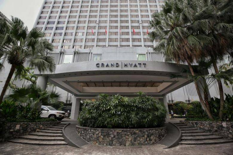 Grand Hyatt Singapore disinfecting hotel after two travellers test ...