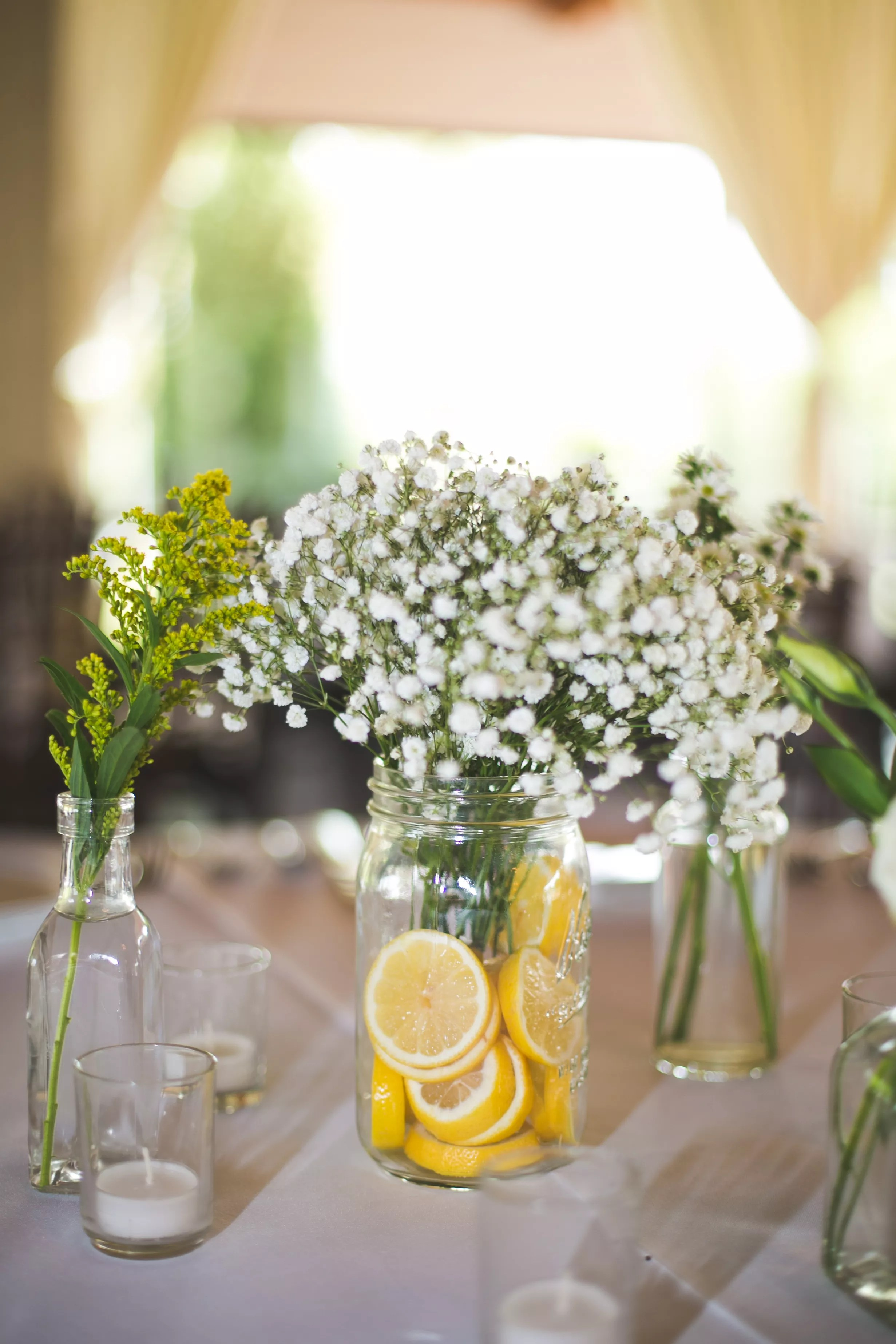 Mason Jars With Babys Breath And Lemon Table Decor