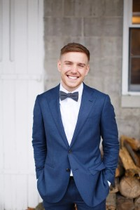 Navy blue suit red bow tie