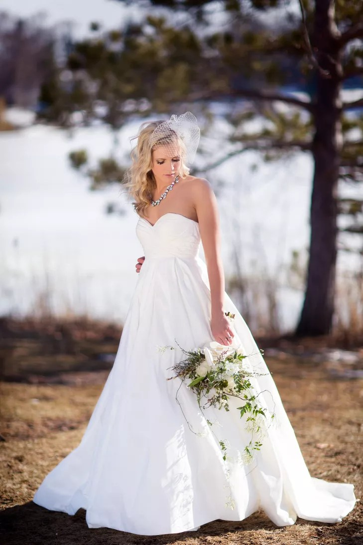 Bride In Strapless A Line Wedding Dress With Down Hairstyle And