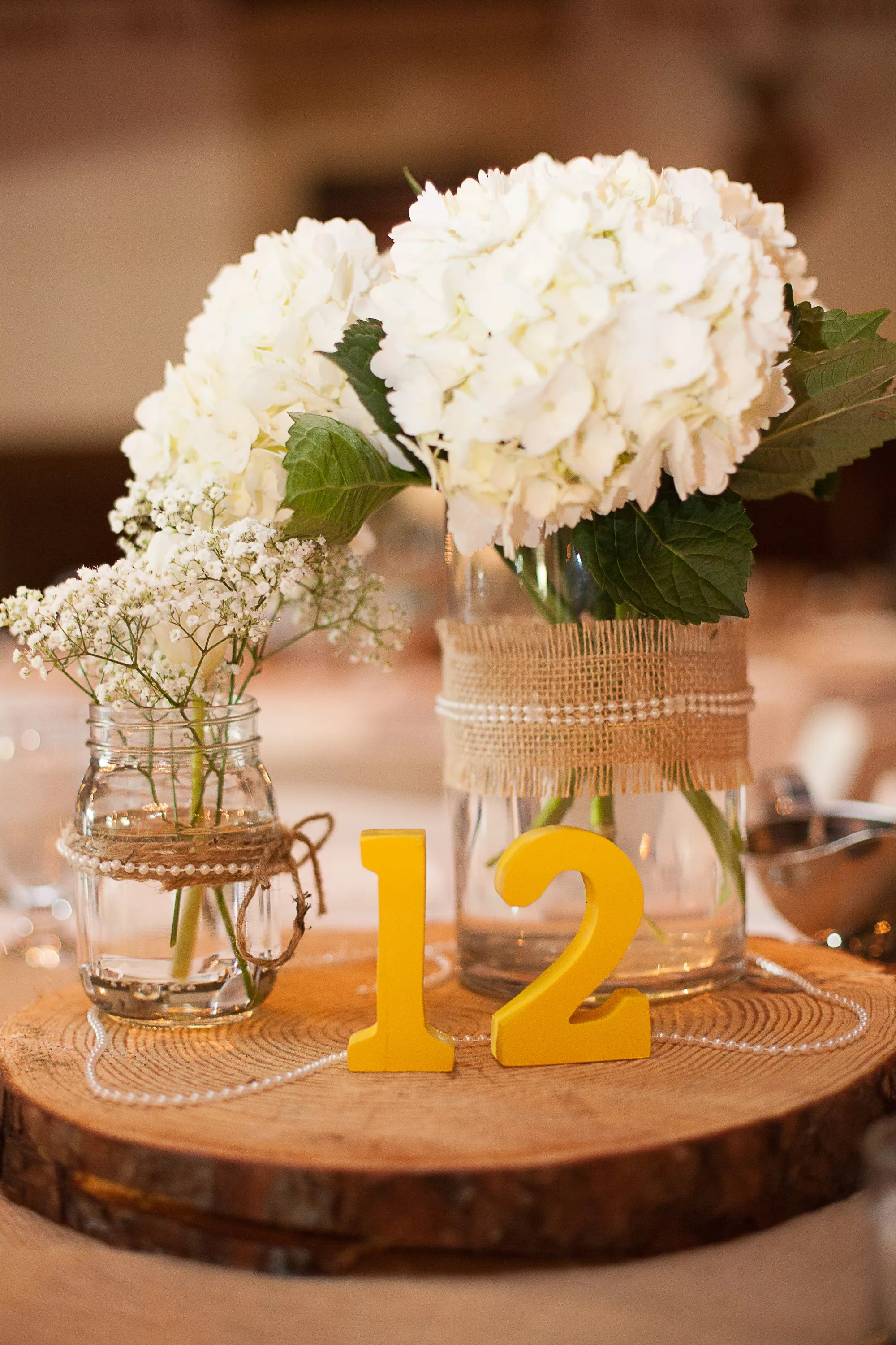 Centerpieces of White Hydrangeas and Babys Breath in