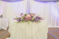 Cascading Purple Flower Sweetheart Table Centerpiece