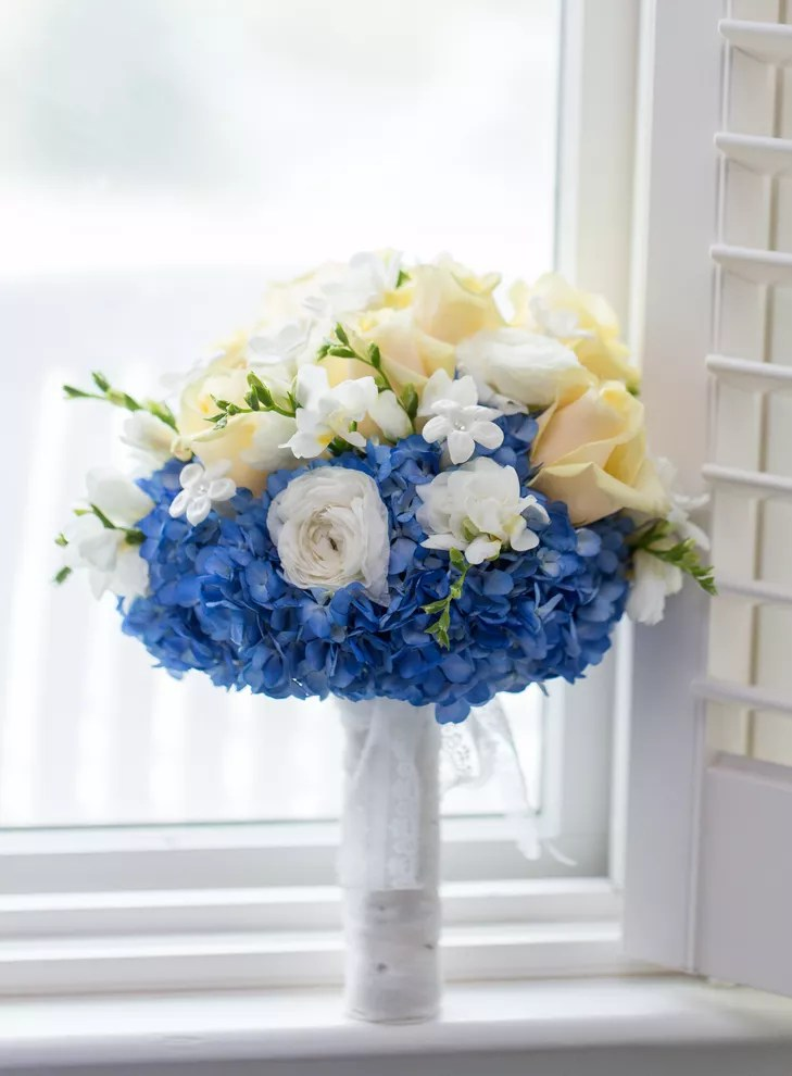 Blue Hydrangea Yellow Rose and White Ranunculus Bouquet