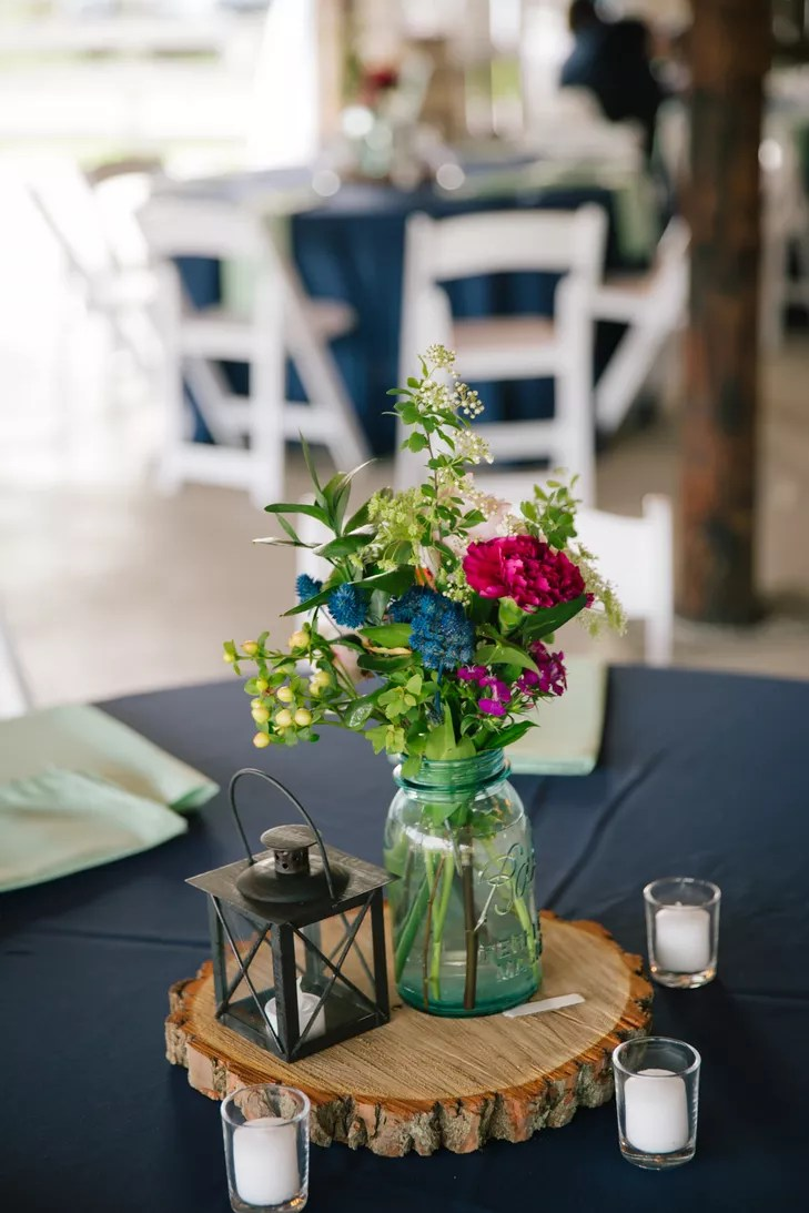 DIY Wooden Slab Centerpieces With Jars and Flowers