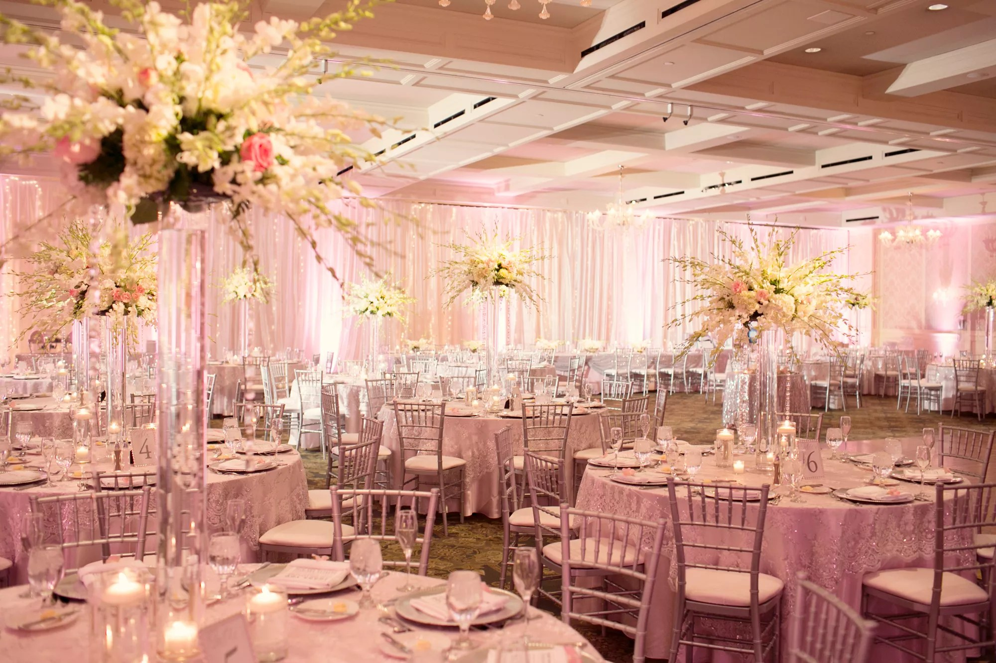 Sparkly Blush Pink Reception Tables and Linens with Tall Ivory Centerpieces