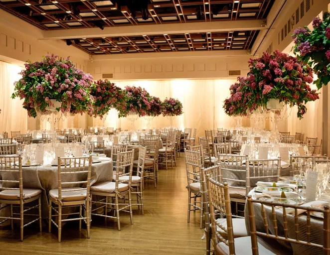 wedding reception with tall floral centerpieces