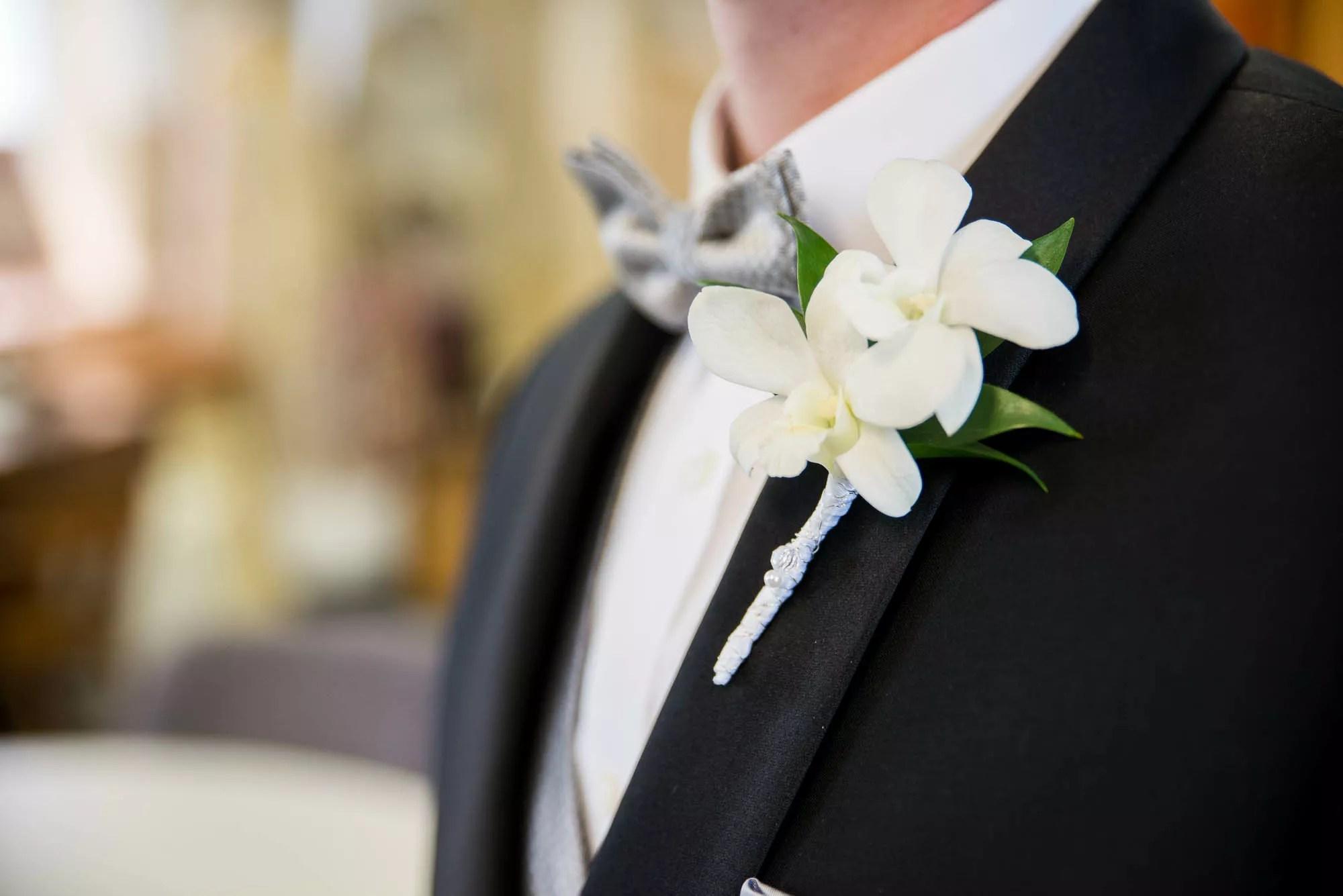 White Gardenia Boutonniere On Black Lapel