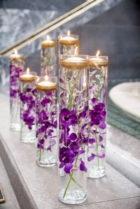 Glass Vases With Purple Orchids and Floating Candles
