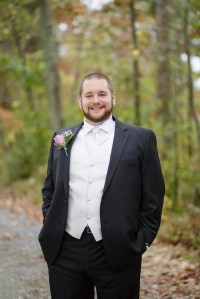 Groom in a White Tie, White Vest and Black Suit