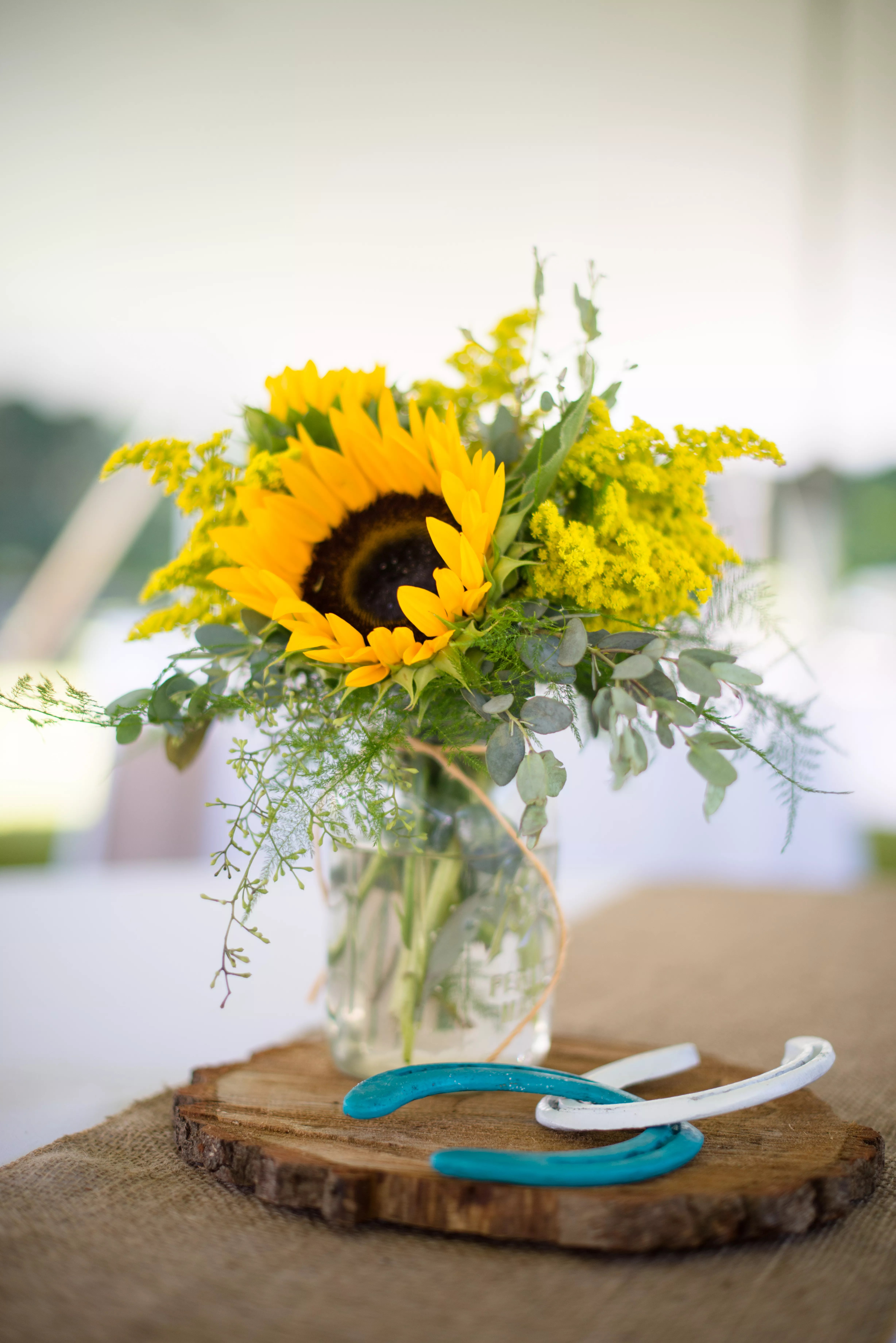 Centerpieces of Sunflowers in Mason Jars on Wood Slabs