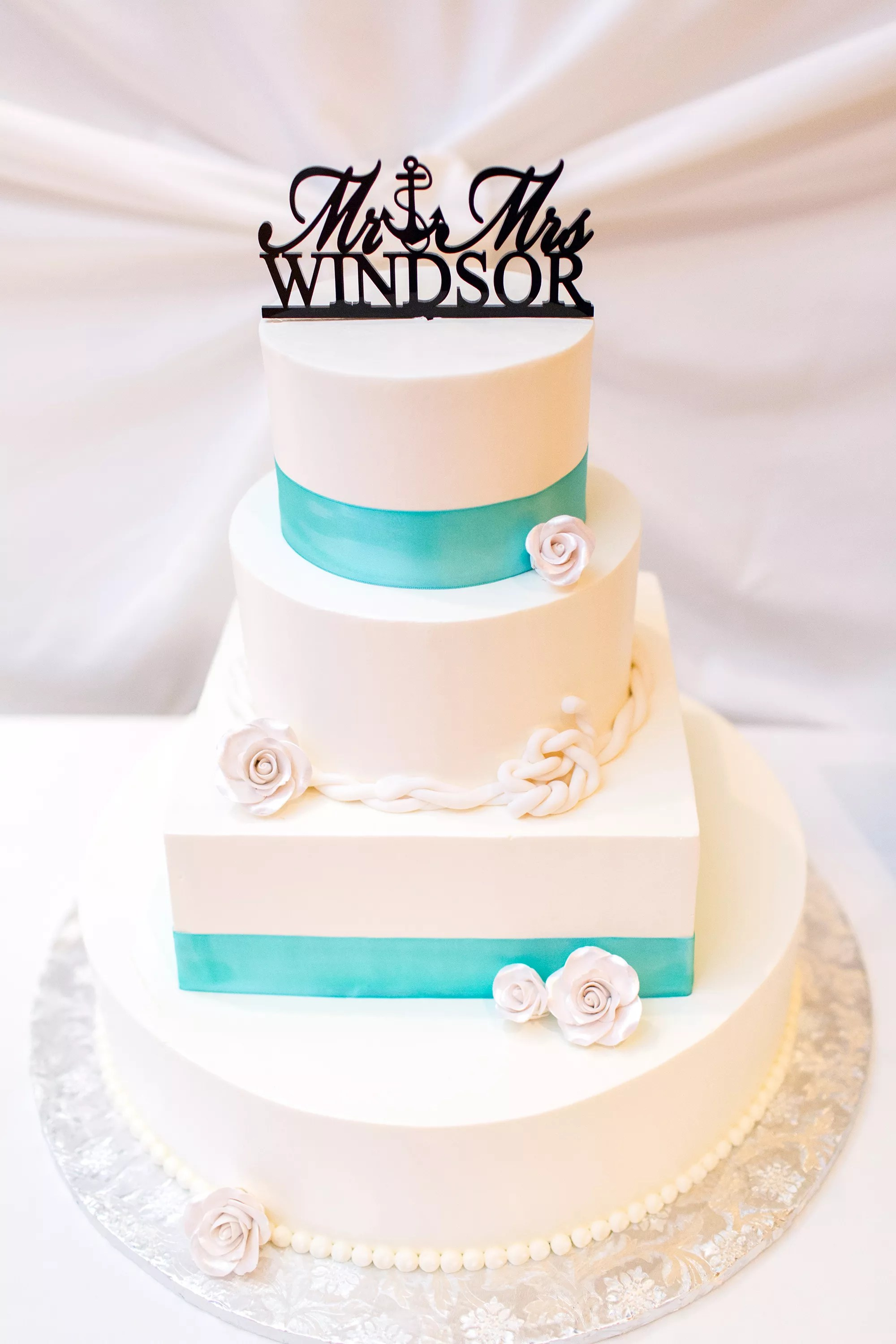 White Wedding Cake With Turquoise Ribbon