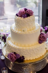 Three-Tier White Wedding Cake, Purple Flowers