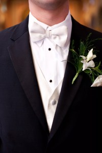 Groom in Black Tux with White Bow Tie