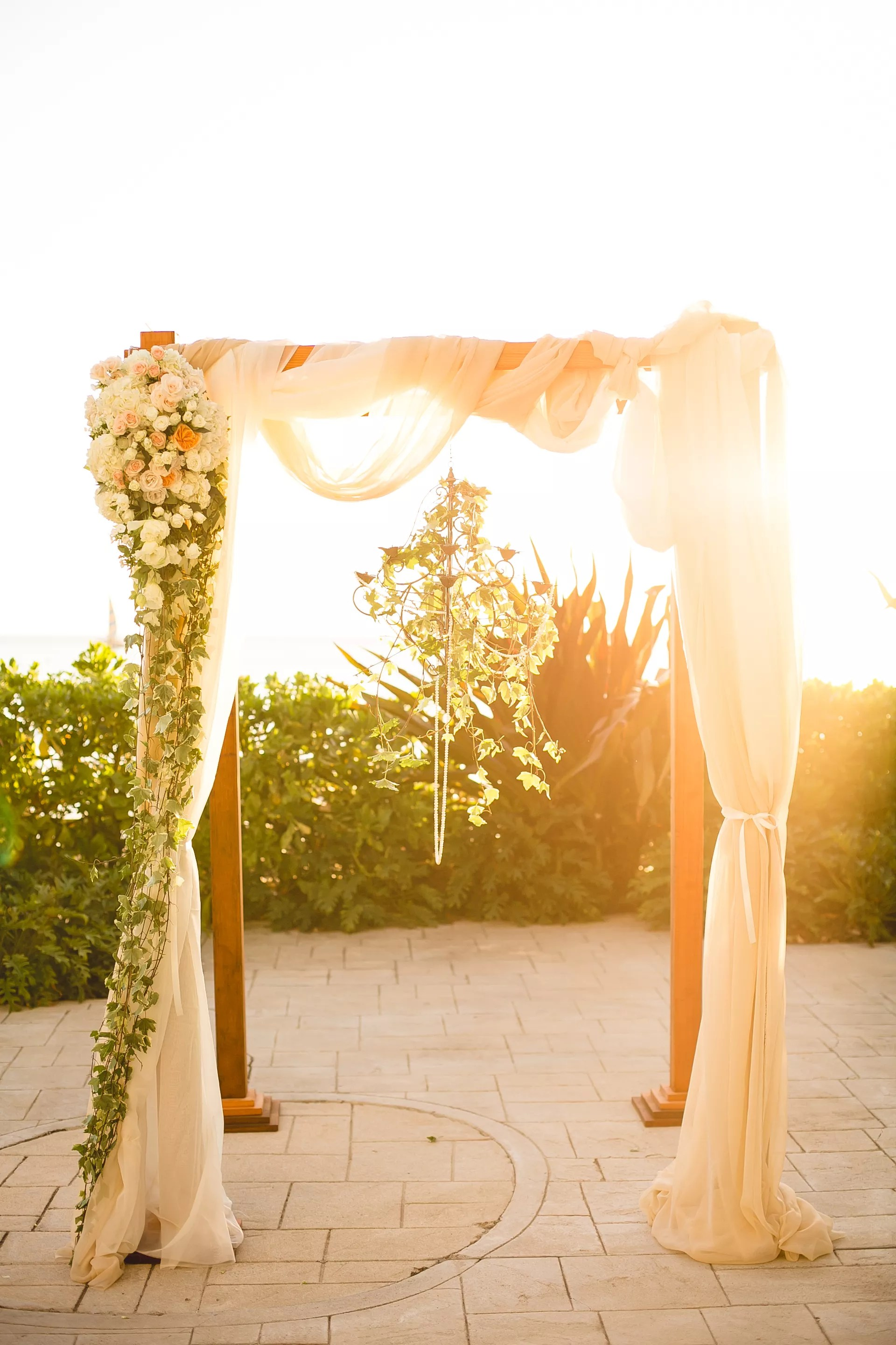 Floral Wedding Arch With Chandelier