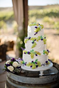 Ivory Wedding Cake Accented with Grape Decor