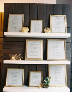 Framed seating chart display accented by gold geometric objects also wedding charts rh theknot