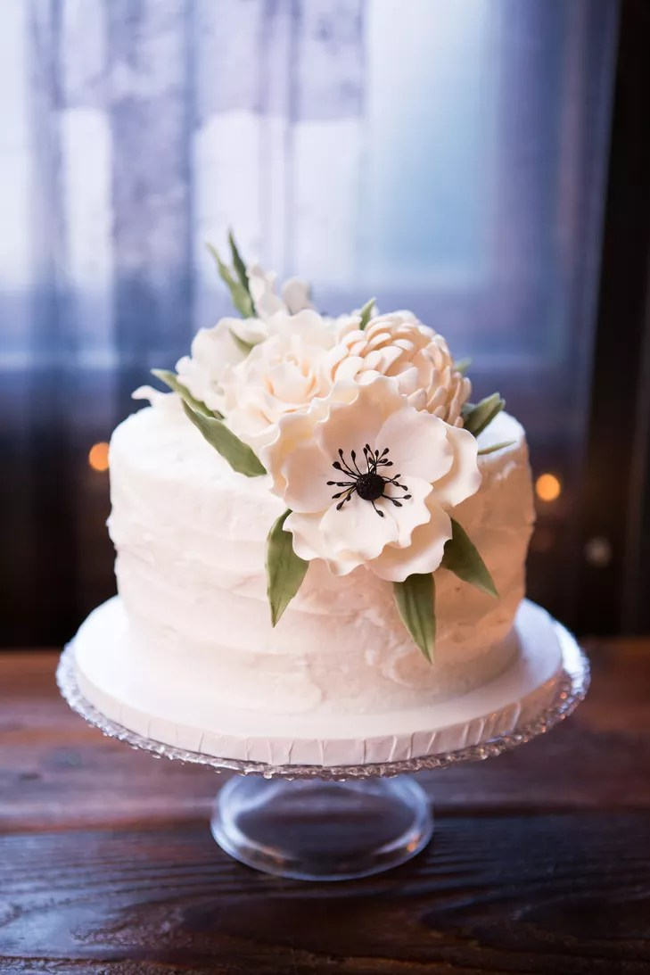 OneTier Wedding Cake With White Fondant Flowers