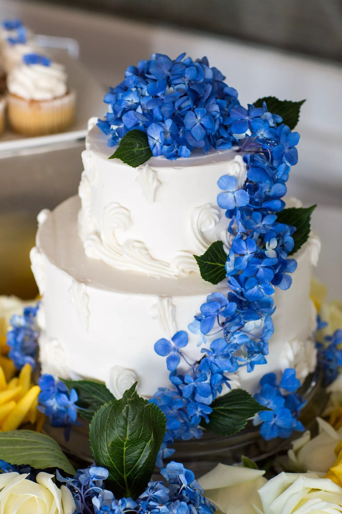 Two Tier Wedding Cake With Cascading Blue Flowers