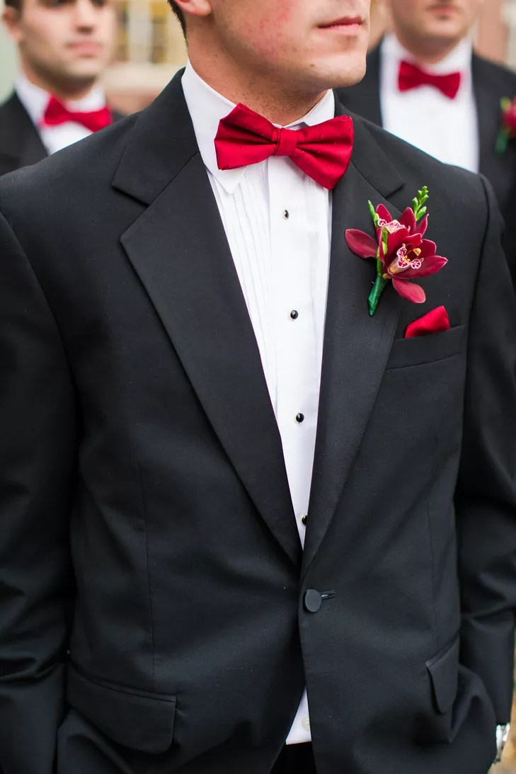 Groomsmen in Black Tuxedos with Red Bow Ties